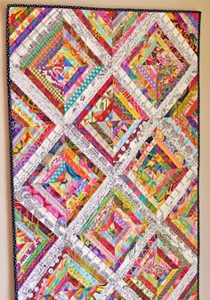 Scrappy Quilt - This scrappy string quilt is a long, skinny wall hanging in a foyer. What a cheerful way to greet guests! Quilting Projects, Quilting Designs, Quilting Ideas, Quilt Modernen, String Quilts, Scrappy Quilts, Flannel Quilts, Quilt Tutorials, Quilt Making