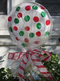 Lollipop Party Decoration~ Paper plates glued/stapled together, colored markers, cellophane, stake of some sort with ribbon of choice.