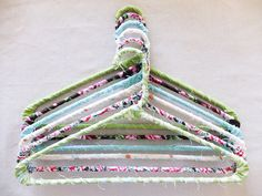 Decorate those old plastic hangers with printed fabric. Makes the clothes stay on better and your closet prettier!