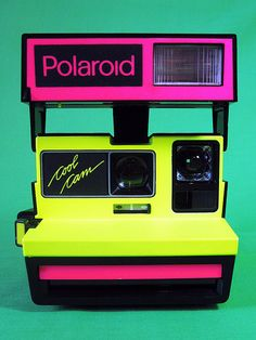 Polaroid camera in neon