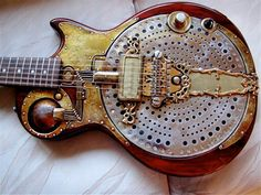 Tony Cochran Guitars The most unique feature of this IonoGlobe electric guitar is the fully wired metal ball right by the neck. Farber Endison played this guitar in the late for a band called The. Cigar Box Guitar, Music Guitar, Guitar Chords, Cool Guitar, Guitar Wall, Steampunk Guitar, Bass Guitars For Sale, Resonator Guitar, Bass Guitar Lessons