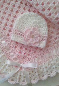 This beautiful hand crocheted granny square baby blanket is made of baby soft yarn. It is made out of a very good high quality yarn.Hand-Crochet Baby Blanket Set Baby Beanie Hat by TheShimmeringRoseBaby beanies haven't been around that much since the Baby Afghan Crochet, Baby Girl Crochet, Crochet Baby Clothes, Crochet Granny, Crochet Blanket Patterns, Baby Patterns, Hand Crochet, Diy Crafts Crochet, Crochet Projects