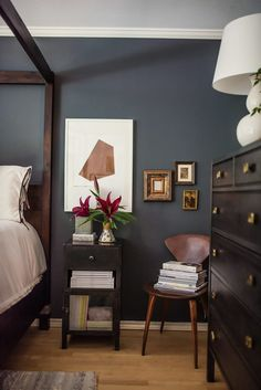 An updated home that masters the retro, groovy look // dark gray painted bedroom walls // dark wood furniture Black Painted Walls, Black Walls, Dark Blue Bedroom Walls, Dark Master Bedroom, Bedroom Wall Colors, Bedroom Decor, Bedroom Inspiration, Paint Ideas For Bedroom, Home Painting Ideas