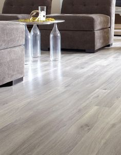 Laminate floor in a dockside oak colour with a premium smooth lacquered finish.