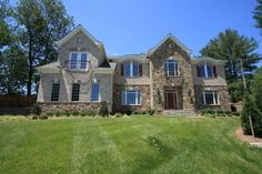 Brittany Model - Stone and brick exterior.