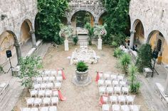 wedding ceremony in courtyards -photo by Lisa Poggi http://ruffledblog.com/chic-destination-wedding-weekend-in-tuscany