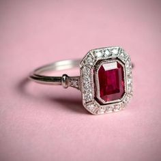 A stunning natural ruby ring centering a carat ruby. A stunning natural ruby ring centering a carat ruby. Surrounding the center gemstone is a row of diamonds. The under-gallery displays beautiful open-work. Ruby Engagement Ring Vintage, Ruby Wedding Rings, Diamond Engagement Rings, Wedding Jewelry, Art Deco Engagement Rings, Solitaire Engagement, Wedding Band, Ruby Jewelry, Fine Jewelry