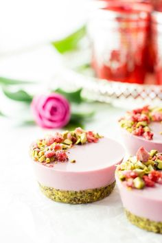 Pistachio, cardamom and strawberry bliss ball mixture used as a cheesecake base. Pistachio, cardamom and strawberry bliss ball mixture used as a cheesecake base. Fancy Desserts, Raw Desserts, Plated Desserts, Just Desserts, Delicious Desserts, Raspberry Desserts, Wedding Desserts, Wedding Cakes, Raw Cake