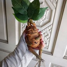 Picked fresh from Professor Longbottoms greenhouses! They were picked before reaching adulthood, so their cries are not yet fatal. *** This listing is for ONE mandrake *** Each mandrake is hand sculpted from clay, then hand painted and topped with faux leaves. Each is completely