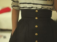 Buttoned high waisted skirt. I need one with no pattern in the fabric and this is a cute button idea!