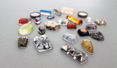 Making Resin Jewelry. I bet my niece Emily would love doing this, as she wears a beetle encased in resin as a bracelet!