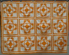 Quilt top done in cheddar and white. 1860-1880. The block is called Bride's Puzzle, or Twelve Crowns, or Wedding March. Collection of Ann Champion