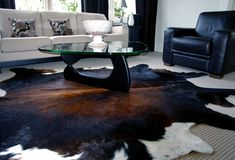 I really like the look of a cow hide rug. I think I would do a faux one. :)