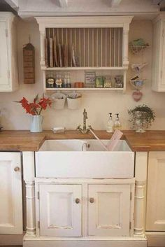 this could be a large dish drainer above the sink (but not above a wood counter) saves so much bench-top space and clutter when they can drip right into the sink. tall narrow windows could be on each side for light and views.