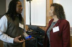 Washington Chapter President Donna Walker talks with #NABJPR attendee Omekongo Dibinga