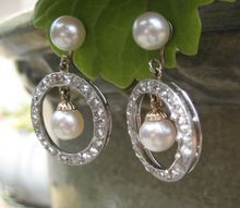 Ice & Cream Deco Diamond and Pearl Platinum 14k Earrings. Exquisitely crafted - these 1930s Deco Diamond and Pearl Earrings harken back to an era when classic chic was all the rage and elegance was in every detail and nuance of a woman's outfit. These Earrings are not only Ice Cream but the Cherry on Top! Rose Cut Diamonds (1 CTW) w/ Cultured Pearls. Circa 1700 Jewelry Line.