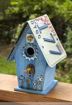Flea Bitten Birdhouse - Steampunk Chic birdhouse decorated with flea market finds -- skeleton keys, a bicycle gear, and a license plate.