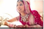 punjabi indian bride in pink lehnga and silver jewelry