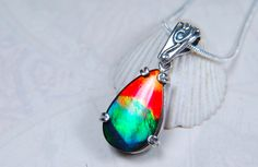 Ammolite Jewelry--a lovely teardrop ammolite pendant in sterling silver---SOLD
