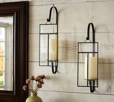love the idea of wall sconces in living room… either candle or lights