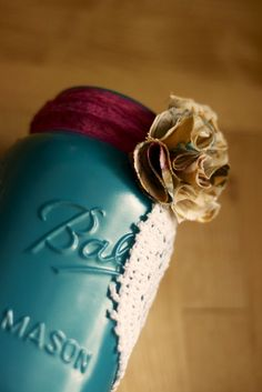 A DIY painted/ribboned mason jar