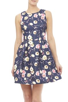 Navy fit and flare dress with a floral pattern, pleated skirt, round neckline an an exposed back zipper closure.   Floral Printed Dress by Moon. Clothing - Dresses - Casual Clothing - Dresses - Floral New York City Manhattan, New York City