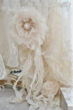 Pretty idea for flower corsage from layers of gathered lace Rosettes.  Add a pretty vintage  button or an old ear-ring or beads for the centre.