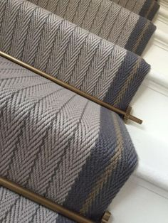 Bespoke Claire Border - Lt Grey, Graphite, Mushroom Our beautiful bespoke flatweave stairrunner in Claire Border in Graphite, Light Grey and Mushroom with antique brass stair rods. This is definitely one of our favourite bespoke creations.