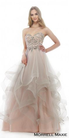 Feel like a modern day princess and dress to impress in this Strapless Sweetheart Cascading Ruffle Ball Gown by Morrell Maxie at your next special event. This glamorous dress features a timeless strapless sweetheart neckline with an enchanting ball gown silhouette. This style also includes a fully beaded bodice and draped tulle netting to create a light cascading ruffle. #edressme