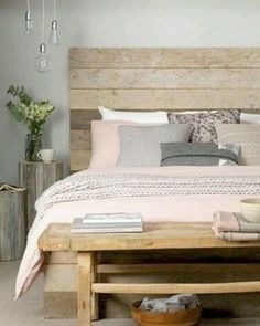 Wooden Panelling Against A Dusted Pink Duvet Counterbalance Eachother To  Create A Calming Bedroom You Can Relax In. Use Decor In Natural Fibers To  Create A ...