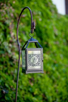 Personalize your deck or lawn decor with this Monogram Lantern with the Ornamental Iron 2 cartridge! #cricut