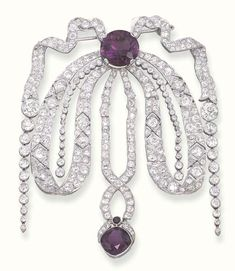A BELLE EPOQUE DIAMOND AND AMETHYST DEVANT-DE-CORSAGE, BY CARTIER   Designed as an old-mine cut diamond pierced bow, with collet diamond aiguillettes, gathered by a circular-cut amethyst suspending a diamond ribbon drop with cushion-shaped amethyst terminal (amethyst probably of later addition), circa 1918, in a Cartier red leather case  Signed Cartier, London, Paris, New York