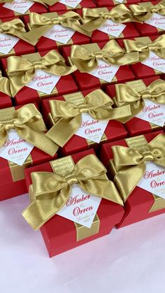 Red & Gold wedding favor box with satin ribbon bow and custom names, Elegant personalized gift boxes make a unique way to thank guests for attending your special day. #welcomebox #giftbox #personalizedgifts #weddingfavor #weddingbox #weddingfavorideas #bonbonniere #weddingparty #sweetlove #favorboxes #candybox #elegantwedding #partyfavor #redwedding #burgundywedding #redandgold #goldwedding #giftboxes #uniqueweddingfavors #uniqueweddingideas