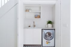 Laundry before and after: Dreamy Euro style laundry behind pocket doors Hidden Laundry, Tiny Laundry Rooms, Laundry Closet, Small Laundry, Laundry In Bathroom, Under Stairs Pantry, Space Under Stairs, Linen Cupboard, Laundry Design