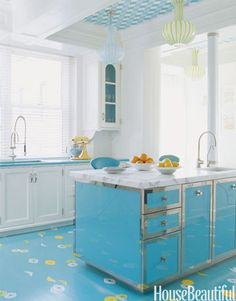 So fun.  Vintage Do you swoon over retro details? Designers William Diamond and Anthony Baratta mixed old and new in this colorful kitchen. The Italian lamps are circa 1960, and the island is custom-made. Accessorize with classic appliances, like a colorful KitchenAid mixer.