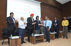 Shri Bhalla giving a cheque to an NGO on behalf of CMIA