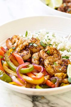Juicy shrimp with cilantro-lime rice and colorful peppers. These shrimp fajita bowls are just like fajitas without the tortilla.
