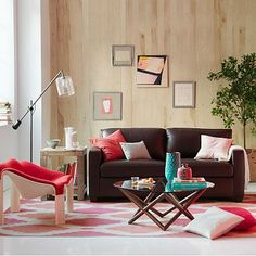 #stylecure  Actually like the slightly chaotic but controlled look and the pops of color.   Henry Leather Sofa #westelm