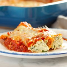 This Baked Ricotta and Spinach Cannelloni is made with three delicious cheeses and it's the perfect easy comfort food recipe that's also vegetarian!