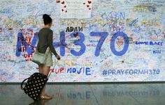 A woman looks at messages of support left for family members and passengers onboard the missing Malaysia Airlines Flight MH370 at the Kuala Lumpur International Airport (KLIA) in Sepang, outside Kuala Lumpur March 18, 2014. — Reuters pic