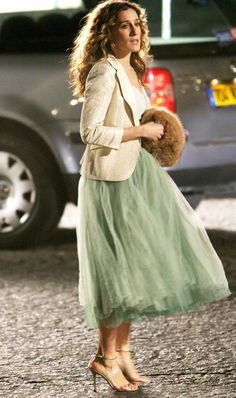 Carrie Bradshaw in green tulle skirt, white top, and golden blazer
