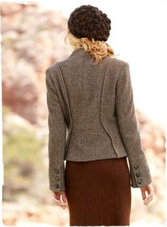 An Italian chevron tweed is tailored with dimensional princess seaming and a peplum hem for a shapely jacket silhouette. With braided leathe...