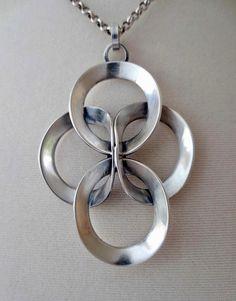 Erik Granit (FI), modernist sterling silver necklace featuring interlocked rings, 1973. #finland | finlandjewelry.com