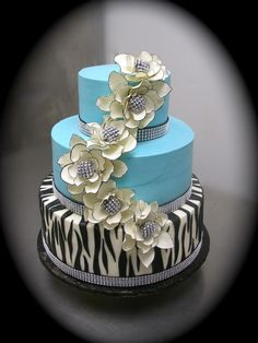16th Birthday Party Cake - This young lady knew exactly what she wanted for her birthday cake.....zebra stripes, bling, turquoise, and fantasy flowers.