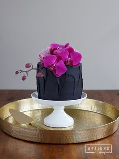 Chocolate Lavender Truffle Cake. Dense chocolate cake layered with rich chocolate truffle ganache and a note of delicate lavender. The perfect Valentine\'s Day treat for you and that special someone. Recipe at www.designsofanyk...