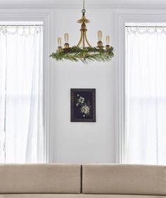 Wreathify a chandelier by winding floral wire (sold at craft shops and nurseries) around bunches of a feathery green, such as white pine, juniper, or cedar, then attaching the greens to the perimeter. Keep the rest of the decor minimal—you want this tricked-out fixture to be the star of the room.