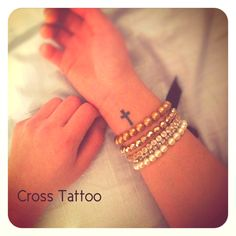 love this cross tattoo