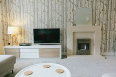 Feature wall using Woods and Pears wallpaper by Cole and Sons