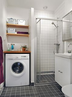 Small Bathroom Laundry Designs laundry - stacked washed & dryer in bathroom, next to shower