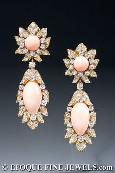 An elegant pair of angel skin coral and diamond earrings. The drops are detachable, so the top can be worn during the day. Circa 1965.